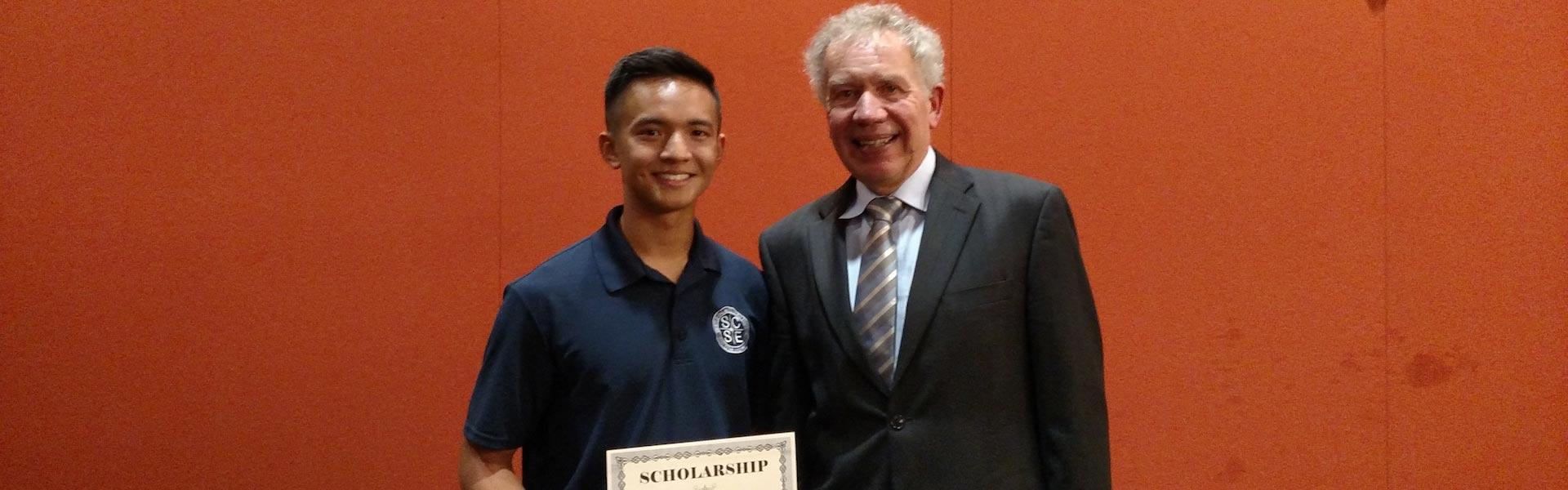 Alan Puah (left in photo), an SE senior, recently received a scholarship awarded by Simpson Gumpertz & Heger (SGH)